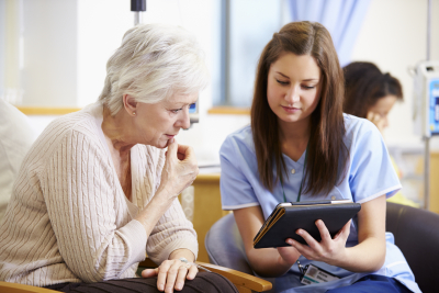 caregiver monitoring the health of the elder lady
