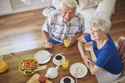 elderly couple with their meals