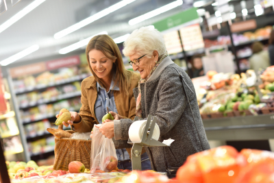 caregiver and elder woman doing grocery shopping