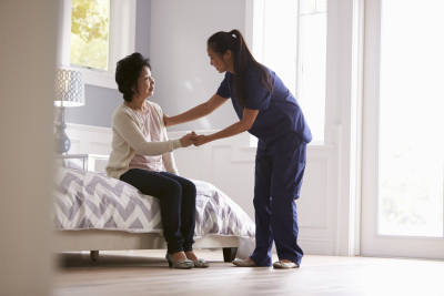 caregiver helping the elderly woman